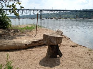Crude log table on a sandy island west of the Boulevard Bridge